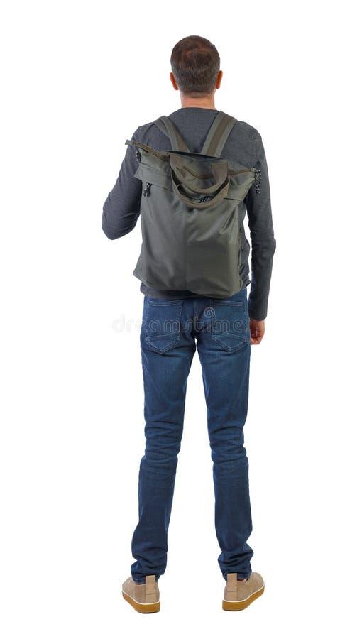 背景是一个带绿袋的男人。背景是一个带绿袋的男人。人的背景。后视图人员集合。隔离于白色背æ 库存图片