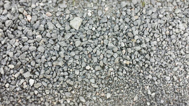 背景有启发性岩石向星期日扔石头 图库摄影