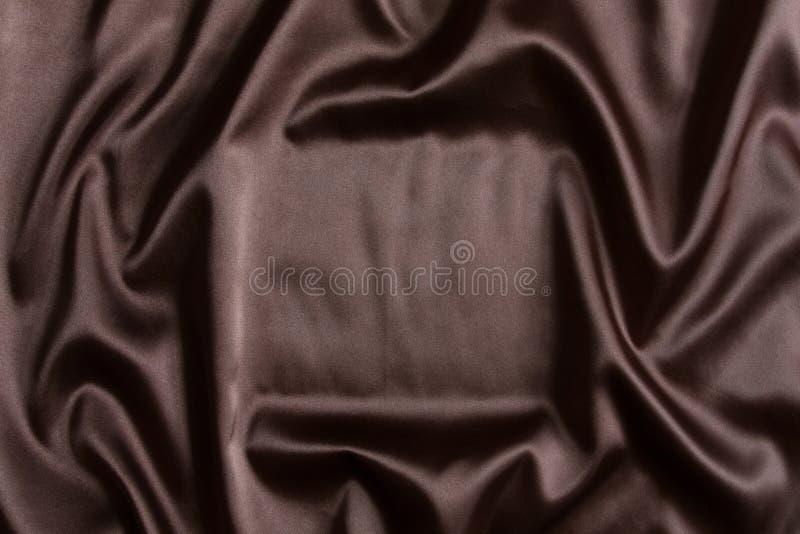 背景棕色丝绸纺织品 图库摄影