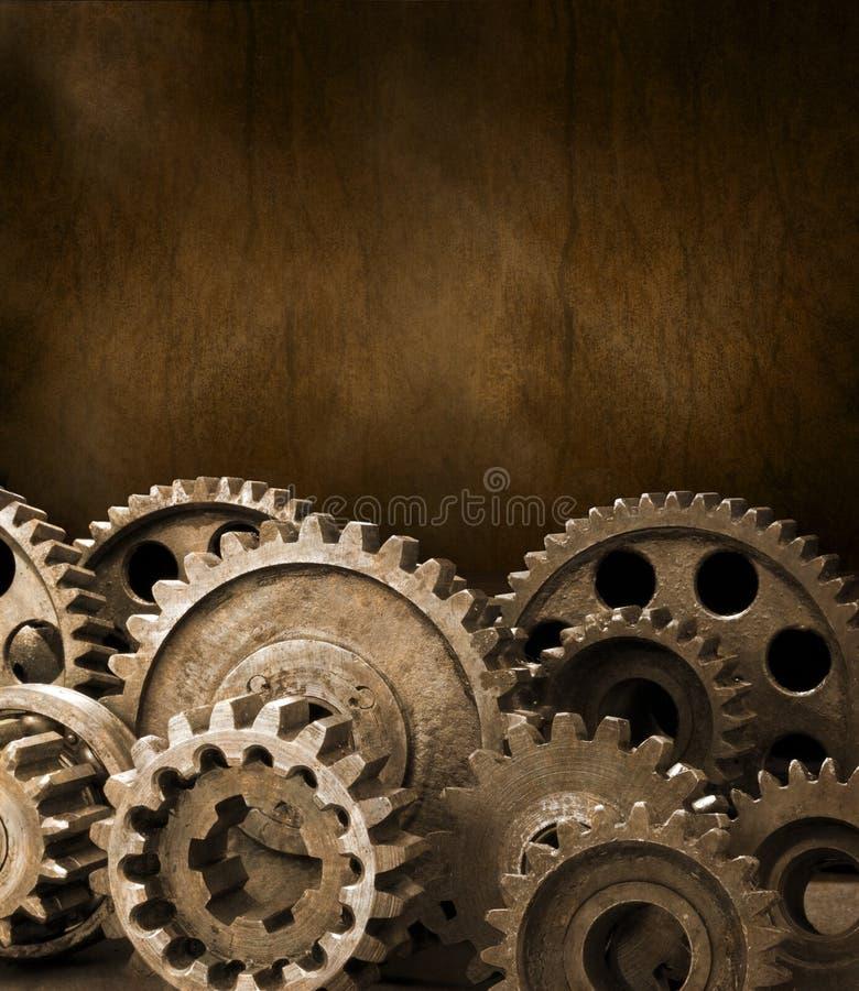 背景棕色嵌齿轮齿轮 免版税库存照片