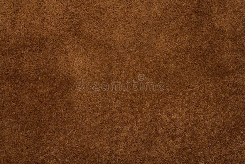 背景棕色自然绒面革纹理 免版税库存图片