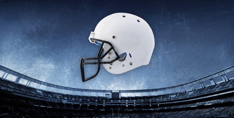 背景橄榄球盔体育场 免版税库存图片