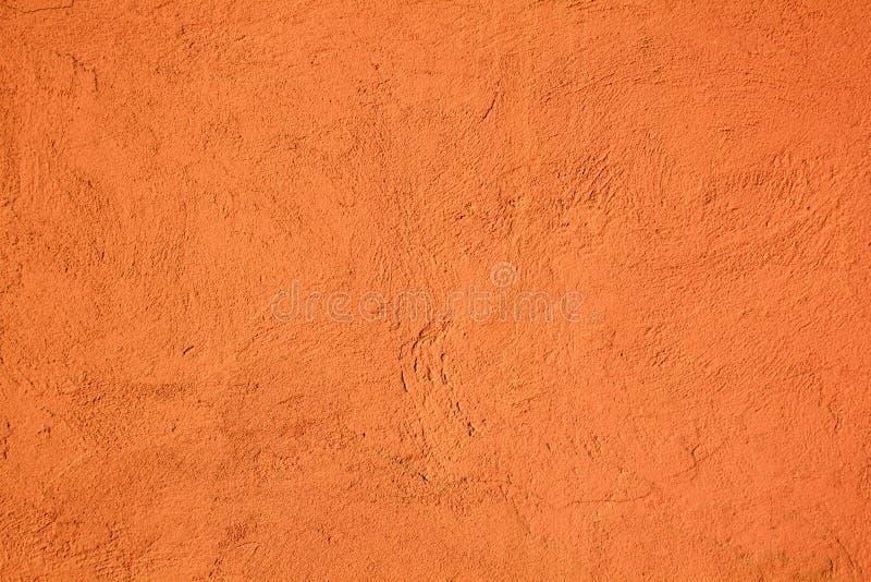 背景水泥墙壁绘了橙色与纹理 库存照片