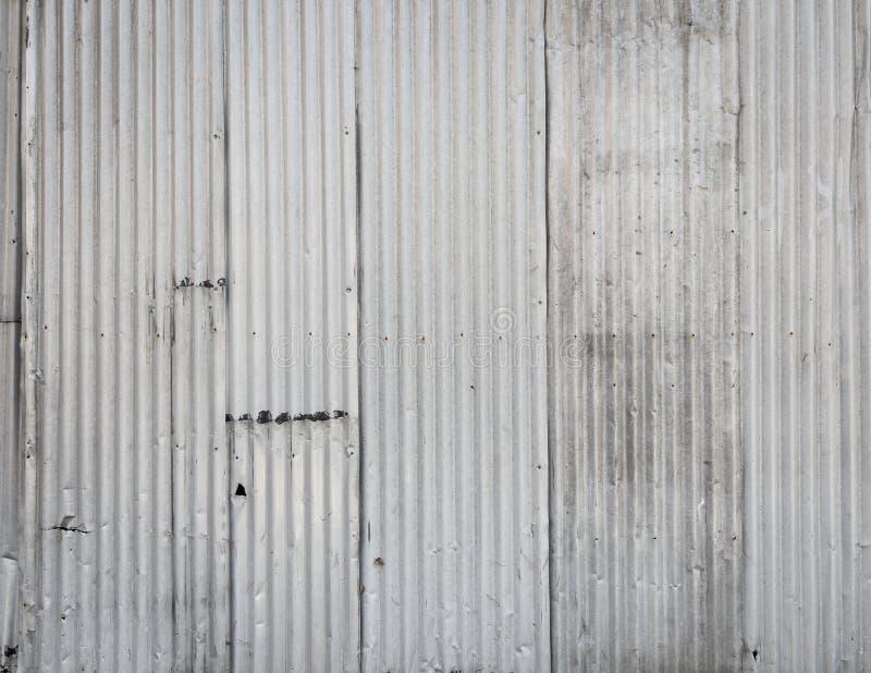 背景波纹状的金属墙壁 免版税图库摄影