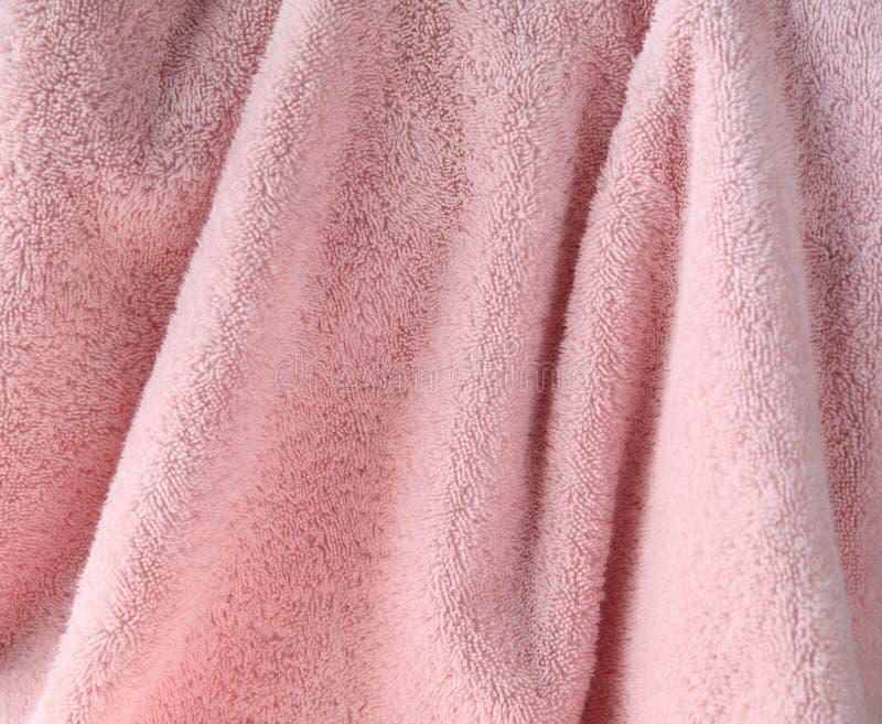背景淡粉红的毛巾 库存图片