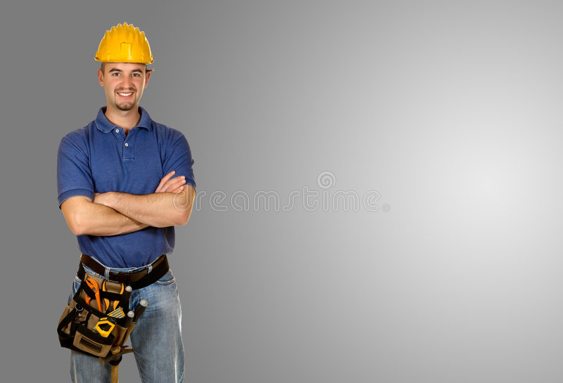 背景灰色手工常设工作者年轻人 库存图片