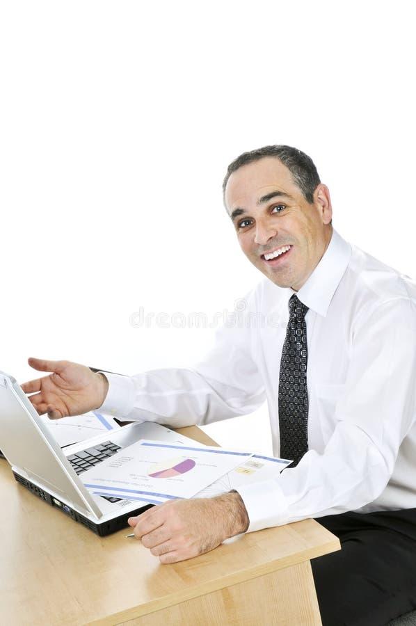 背景生意人服务台他的白色 免版税库存照片