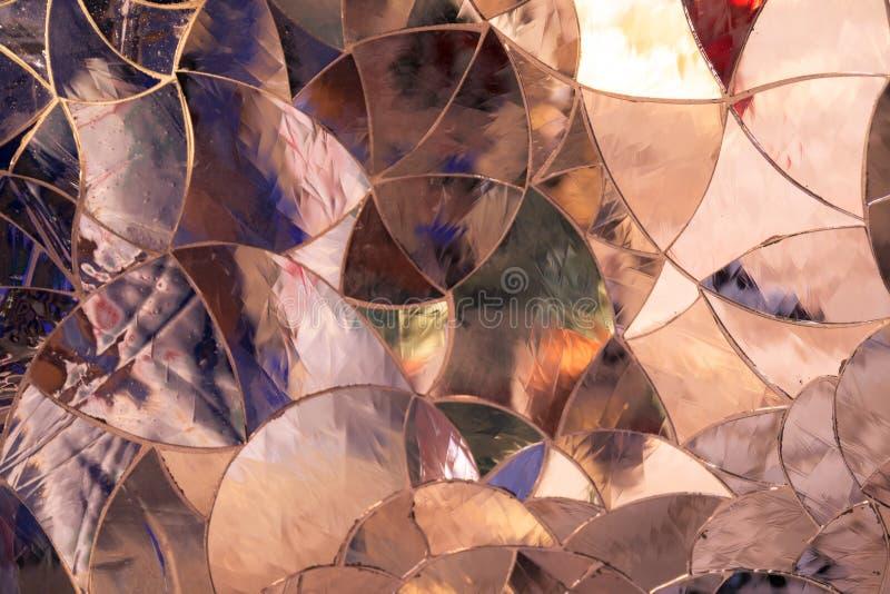背景由色的玻璃片断形成了一起被加入象a 库存照片