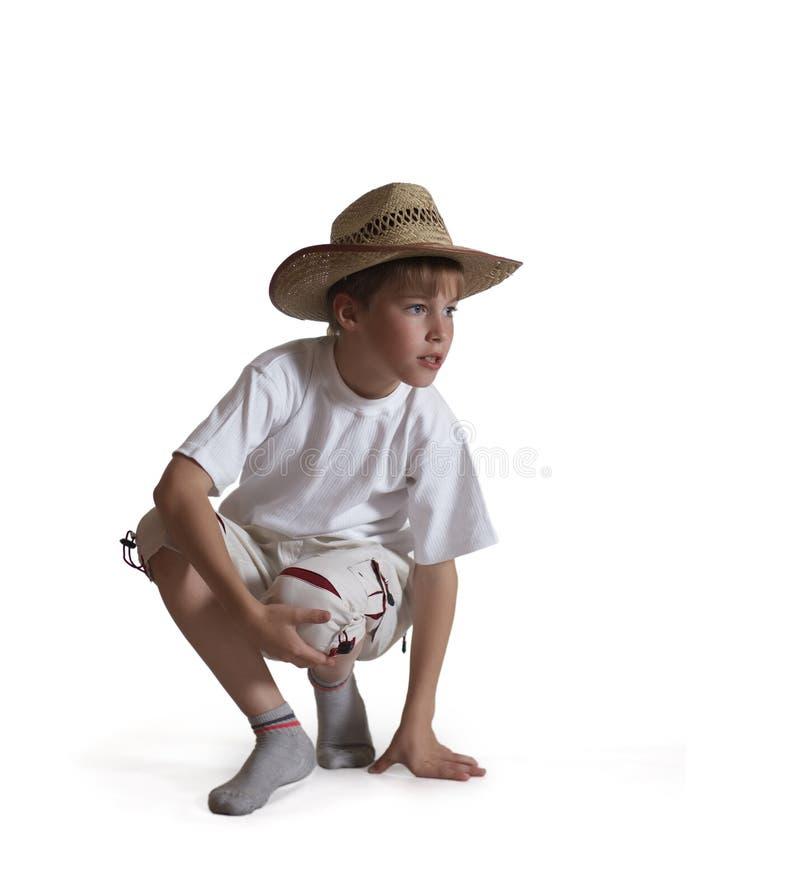 背景男孩帽子坐的秸杆白色 图库摄影