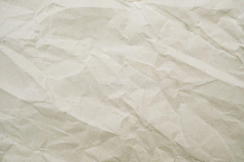 背景的压皱纸纹理 与拷贝空间的弄皱的牛皮纸 库存照片
