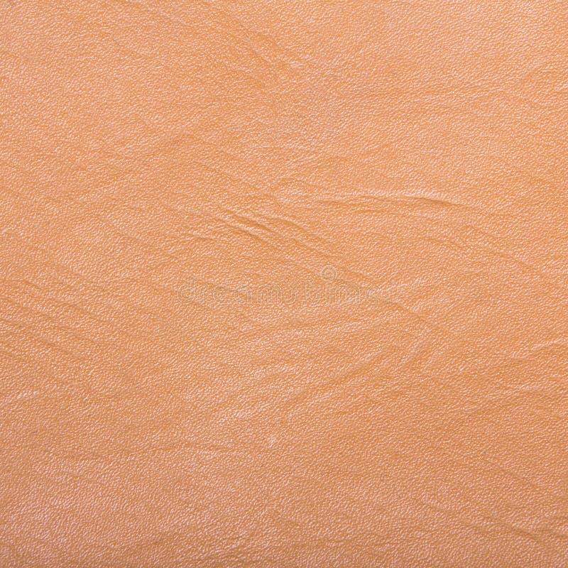 背景的橙色人造革 库存照片