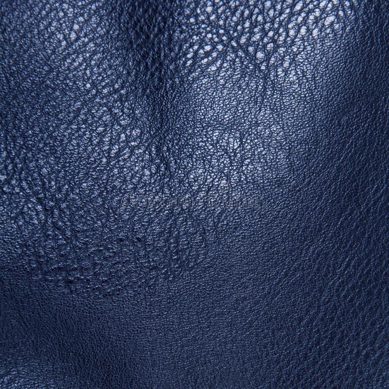 背景的深蓝人造革 免版税图库摄影