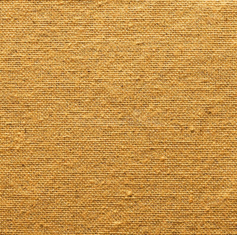 背景的金黄亚麻制纹理 免版税库存照片