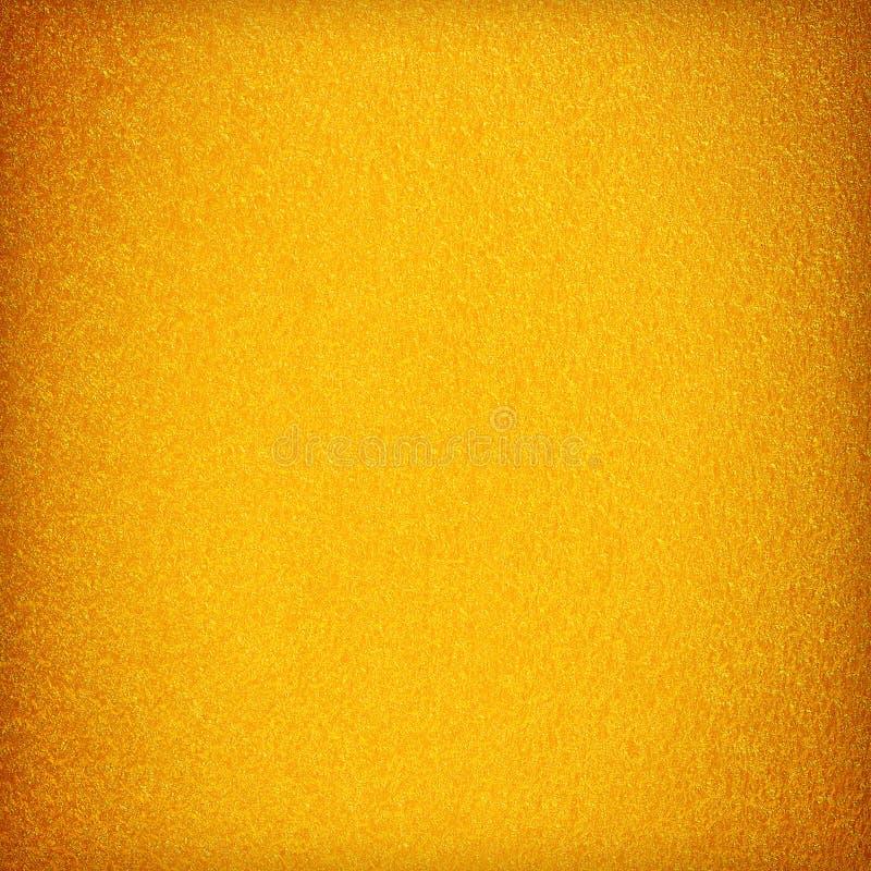 背景的金黄被绘的水泥具体纹理 库存照片