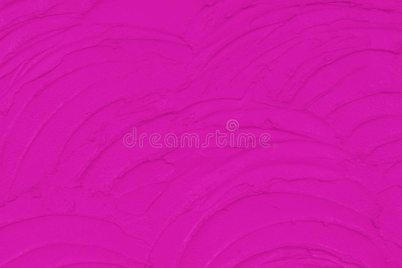 背景的,在水泥墙壁上的结构膏药桃红色具体纹理 免版税库存图片