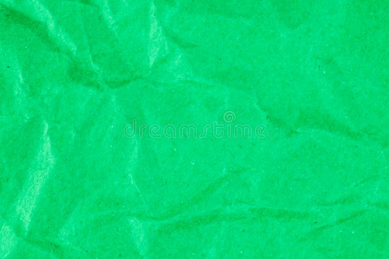 背景的,绿色被弄皱的绿皮书纹理回收纸背景 免版税库存图片