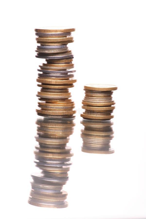 背景硬币查出反映白色 库存照片