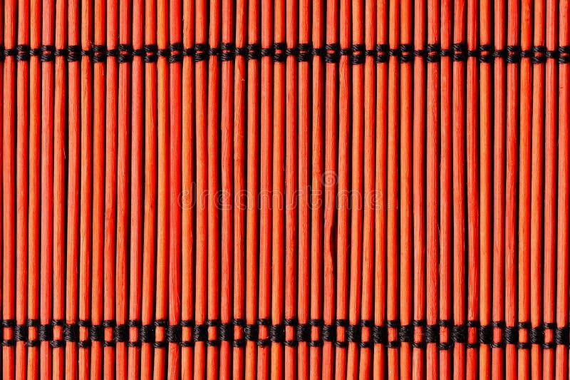背景竹布料红色表 免版税库存图片