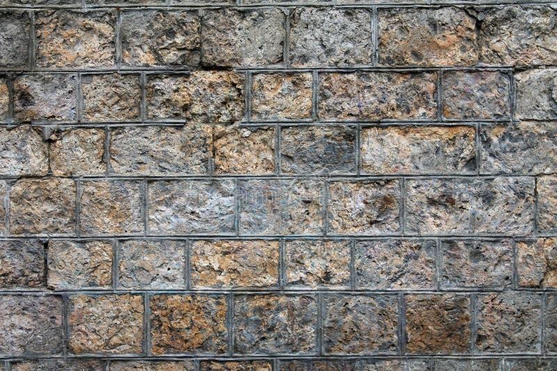 背景粗砺的石墙 库存照片