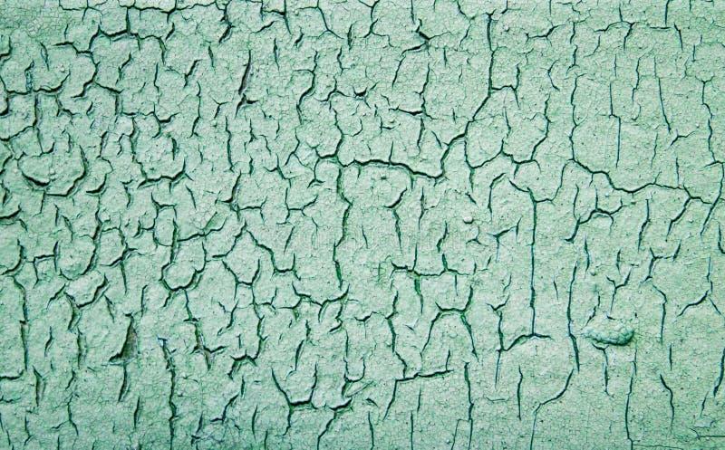 背景纹理绿色墙壁年迈的破裂的油漆 免版税图库摄影