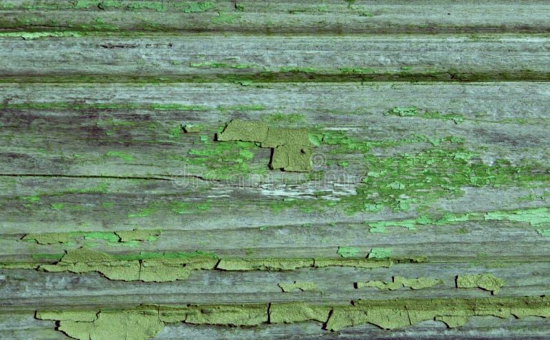 背景纹理绿色墙壁年迈的破裂的油漆 免版税库存照片