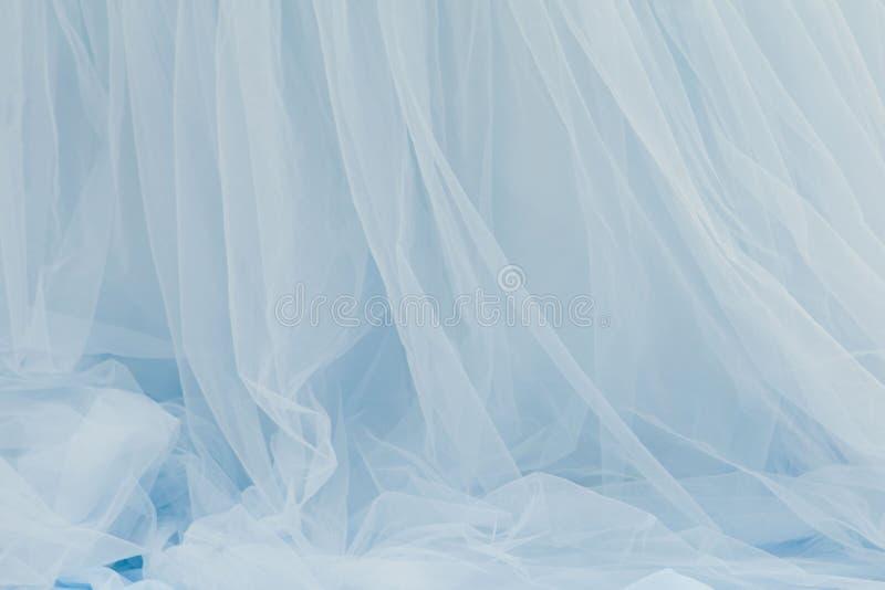 背景织品fatin淡色蓝色扭转 免版税图库摄影