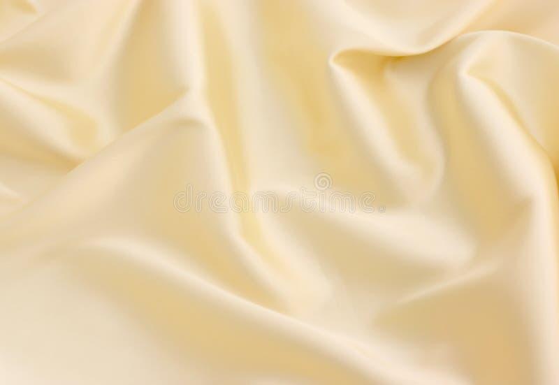 背景缎黄色 库存照片