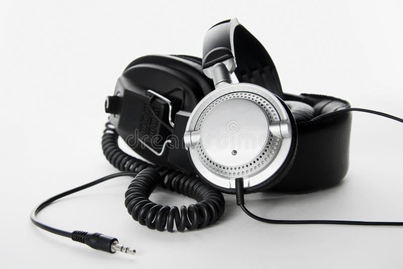 背景耳机二白色 免版税库存照片