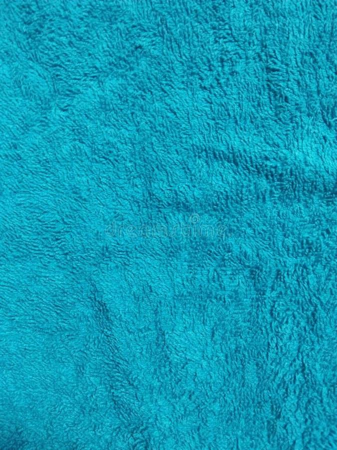 背景蓝全框织构织物彩色背景纹理效应材料摘要 免版税库存图片