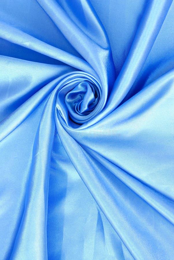 背景蓝色典雅丝绸使光滑 库存图片