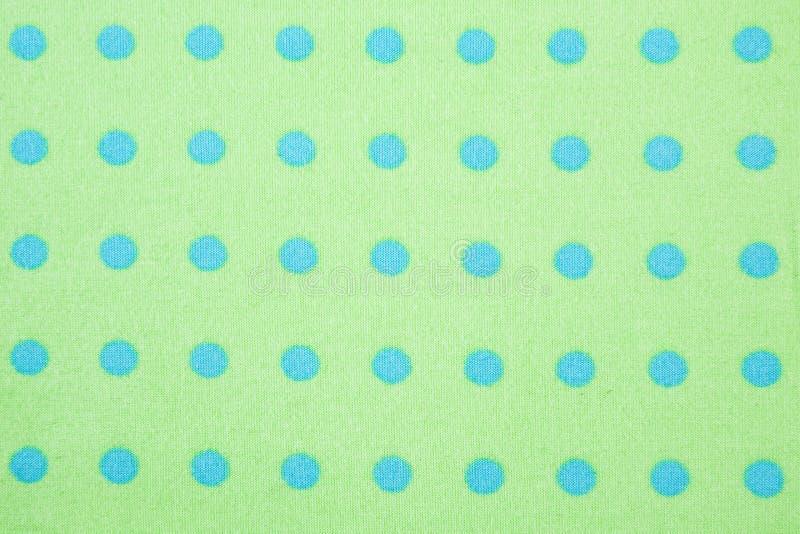 背景蓝色加点绿色模式短上衣 库存图片