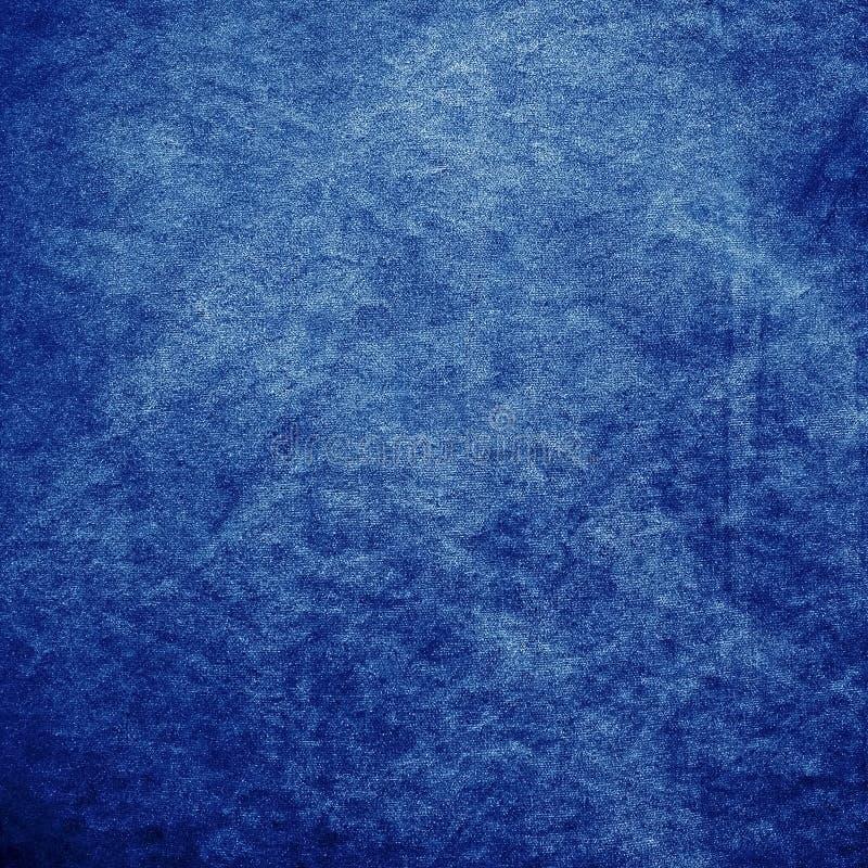 背景蓝色织品斜纹布 库存图片