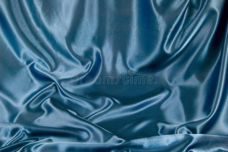 背景蓝色缎纹理 库存照片