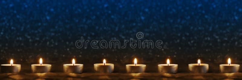 背景蓝色蜡烛 免版税图库摄影