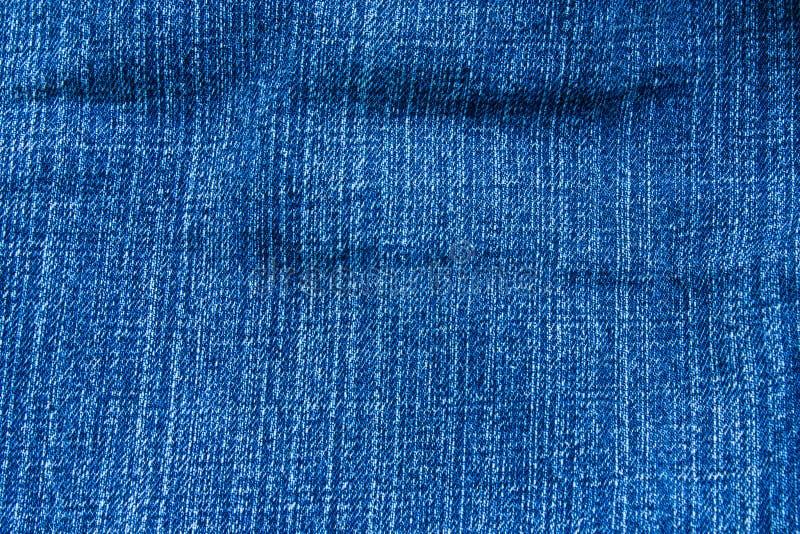 背景蓝色衣物denims牛仔裤纹理 图库摄影
