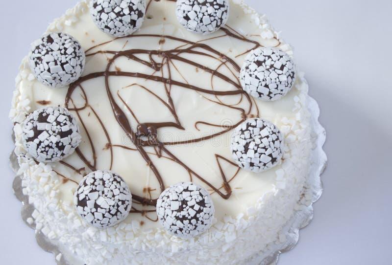 背景蛋糕灰色查出的白色 库存图片