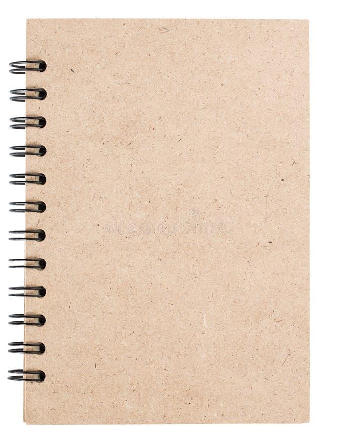 背景褐色查出的笔记本白色 库存图片