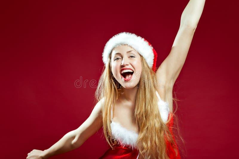 背景辅助工性感红色的圣诞老人 免版税库存图片