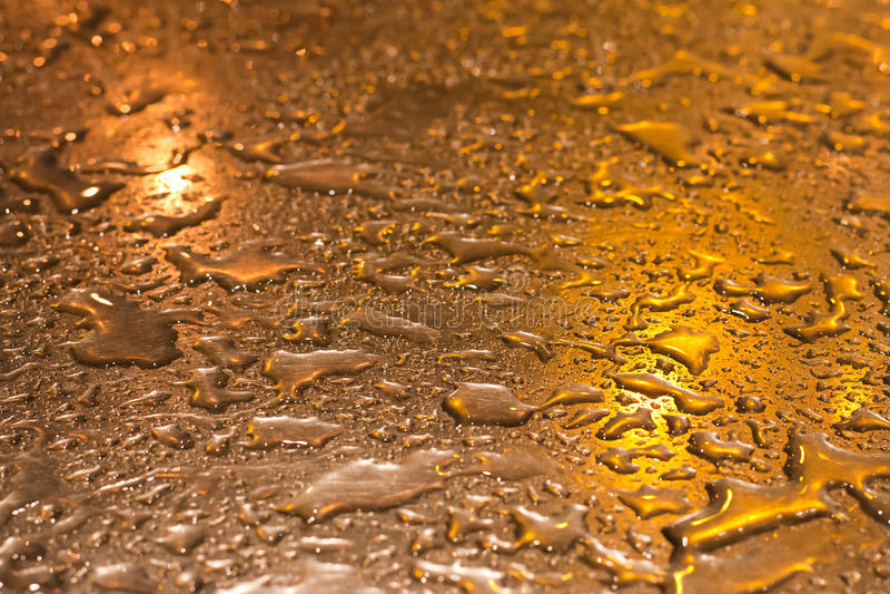 背景金金属发光的表面 库存照片