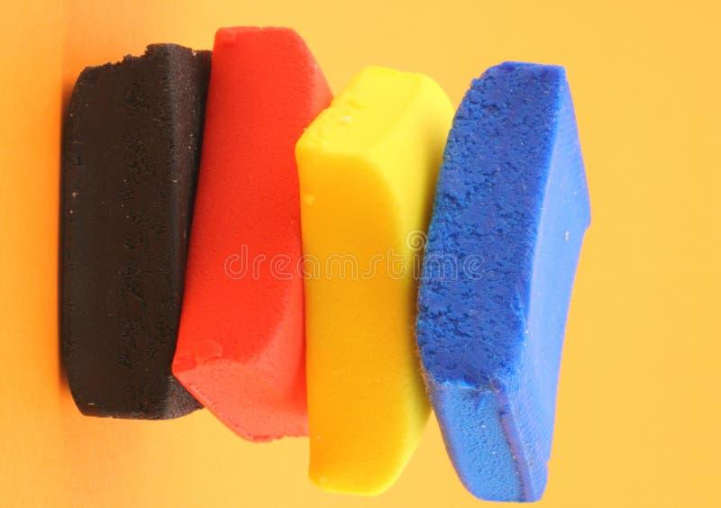 背景阻拦五颜六色的橙色堆彩色塑泥 免版税图库摄影
