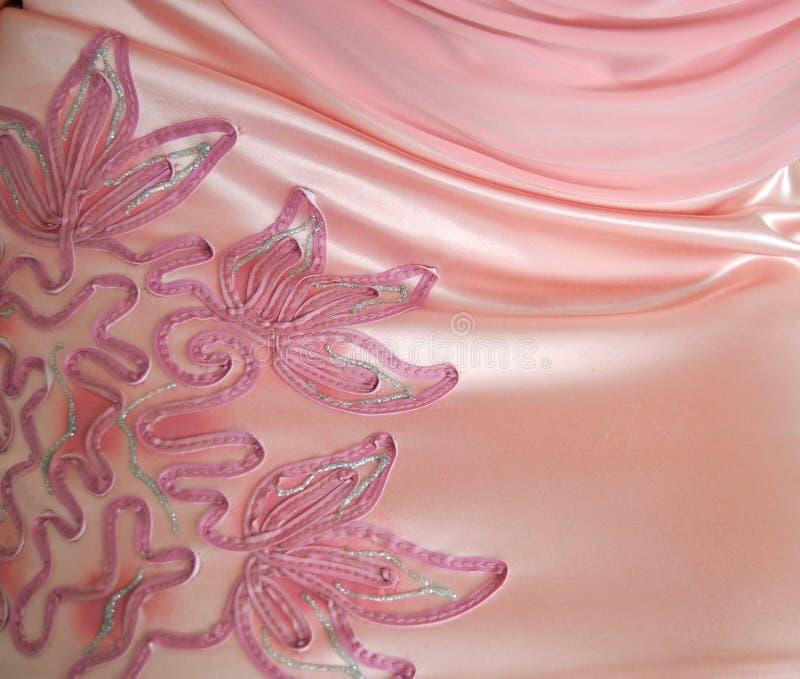 背景鞋带玫瑰色丝绸 免版税图库摄影
