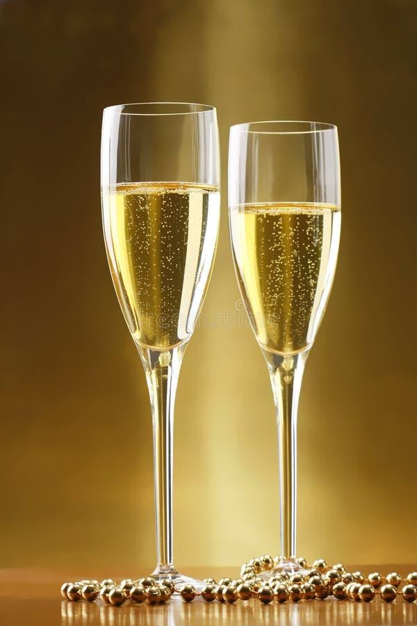 背景香槟玻璃金子 库存照片