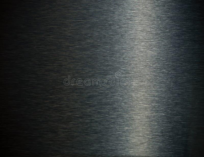 背景黑暗的不锈钢 库存照片