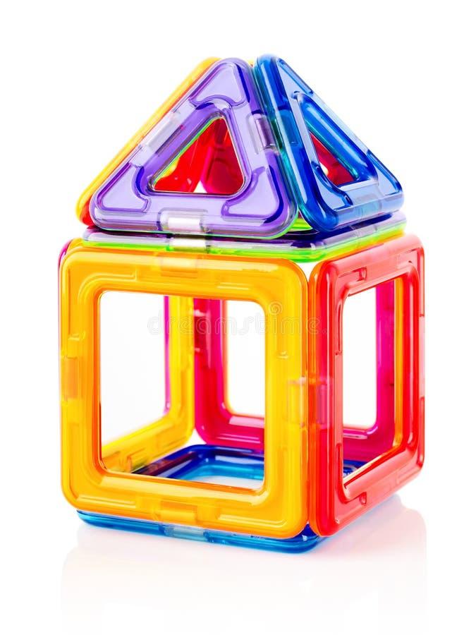 背景黑色儿童现有量房子玩具 免版税图库摄影
