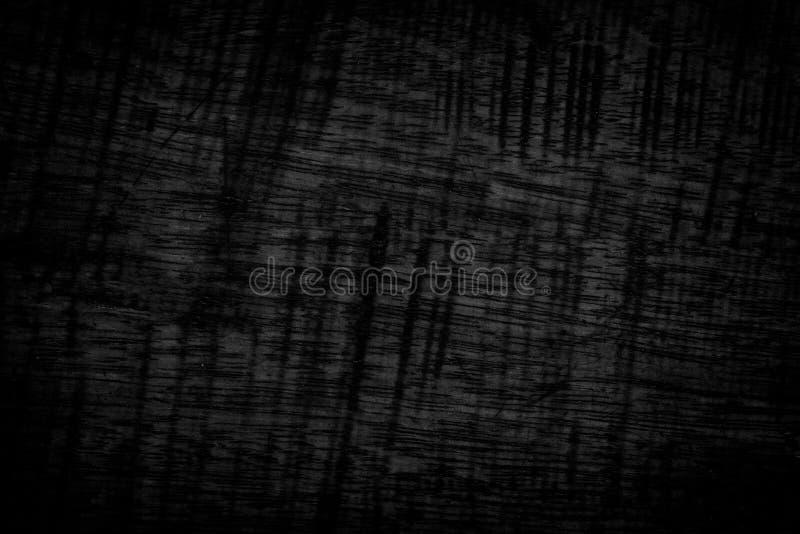 背景黑色grunge纹理 在困厄的木难看的东西纹理 图库摄影