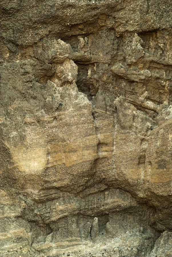 背景,纹理-被风化的岩石墙壁 图库摄影