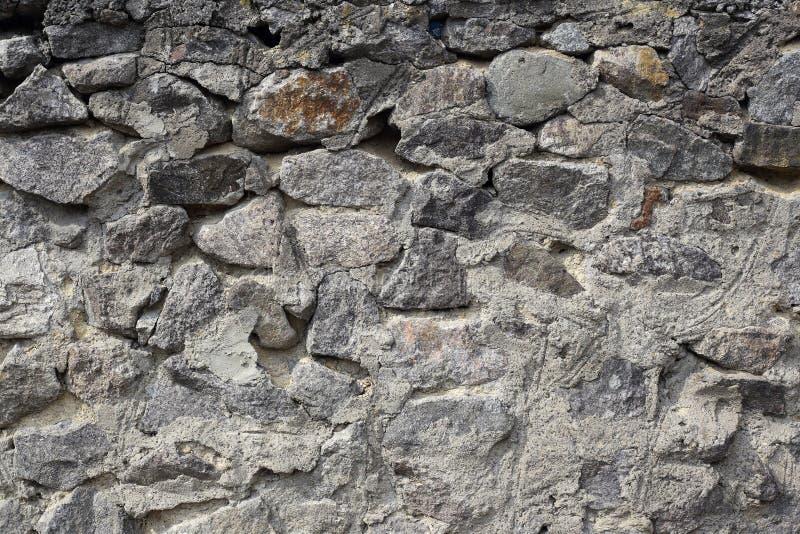 背景,被构造-抽象灰色石金属砖墙 免版税库存图片