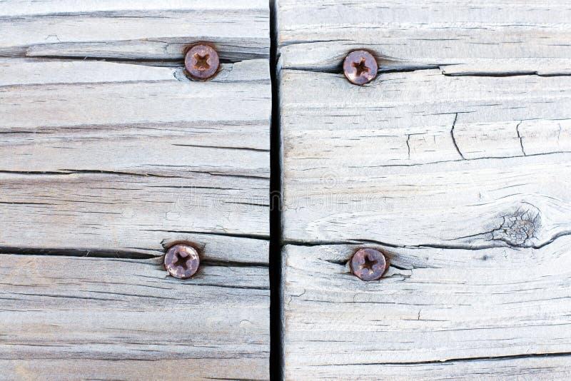 背景grunge联接对待的木头 免版税库存图片