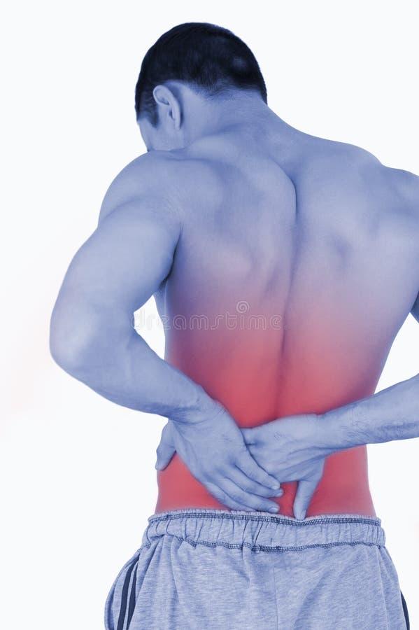 从背部疼痛的年轻男性痛苦 免版税库存图片