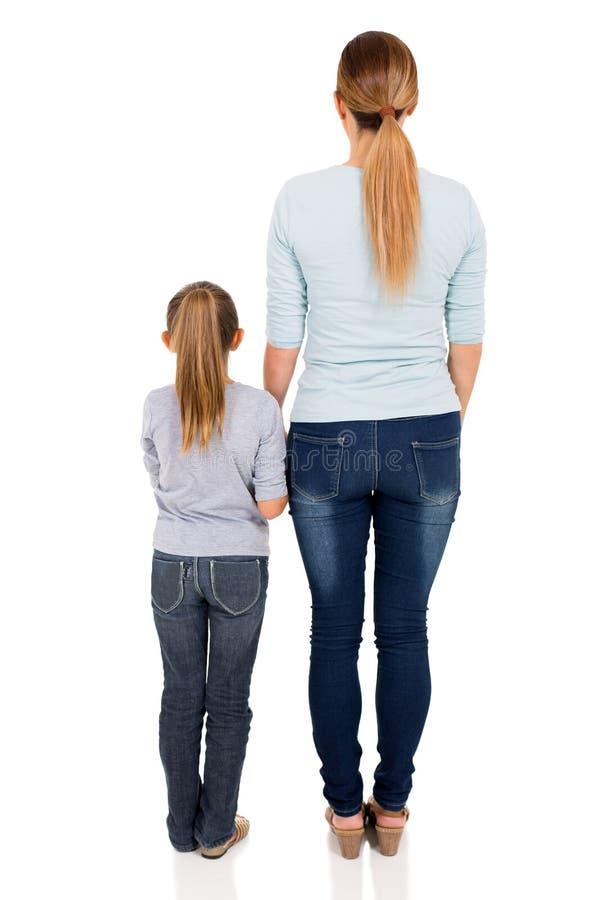 背面图妇女女儿 库存图片